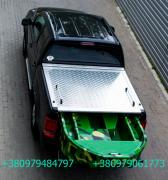Cover bed of a pickup truck. The trunk lid is for pick-up. Cover for PI