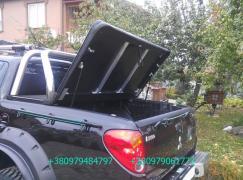 Крышка кузова пикапа. Трёхсекционная крышка багажника пикапа